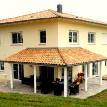 Gelbes Einfamilienhaus erstellt durch die Fa. Andreas Bauer GmbH in Mitterskirchen